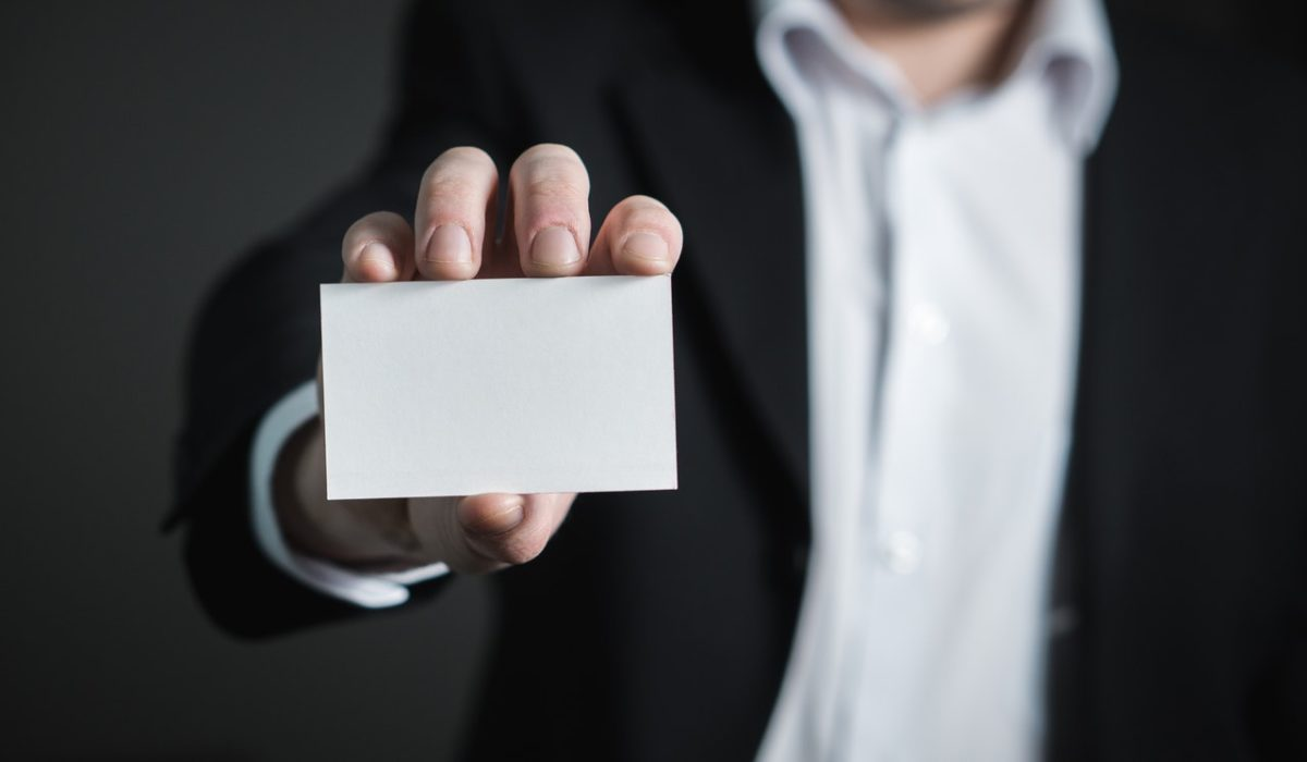 a person holding a business card