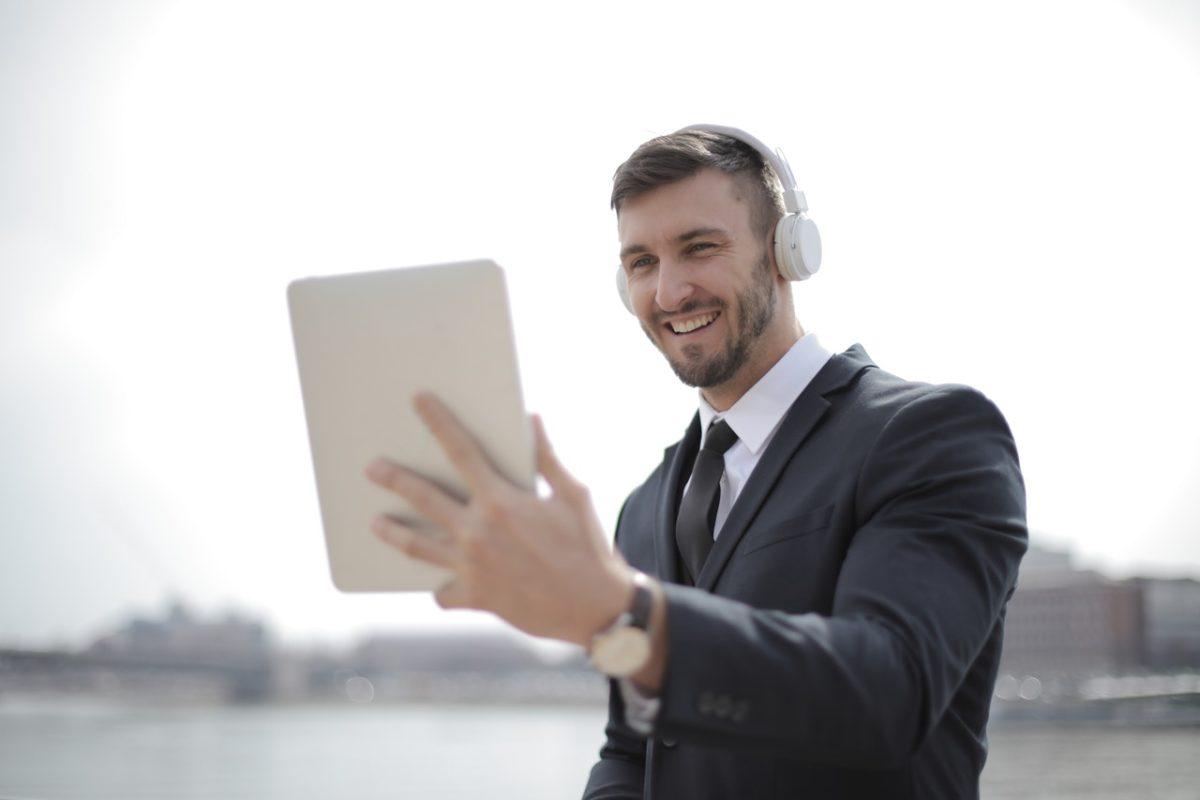 a man with an ipad