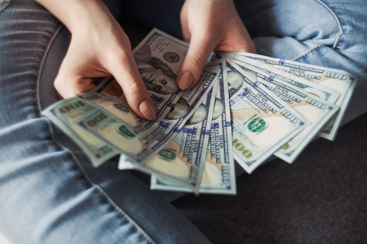 a person holding money