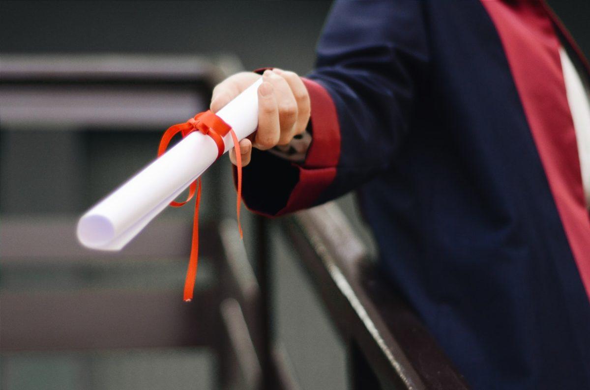 a graduate holding a paper